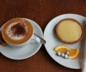 At The Bridge Patisserie, a delicious lemon curd tart and cappuccino.